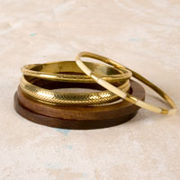 Gold and Wood Bangle Set ($9, Claire's)