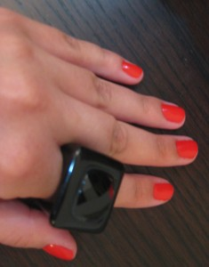 Red nails, black ring