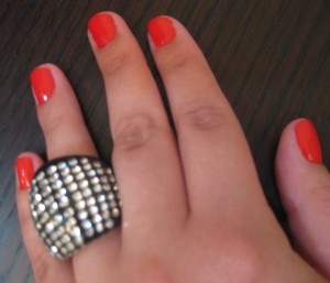 Red nails, black sparkly ring