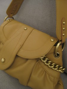 Leather purse with gold chain embellishments