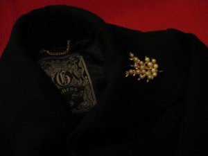 Pea coat with gold and pearl flower brooch